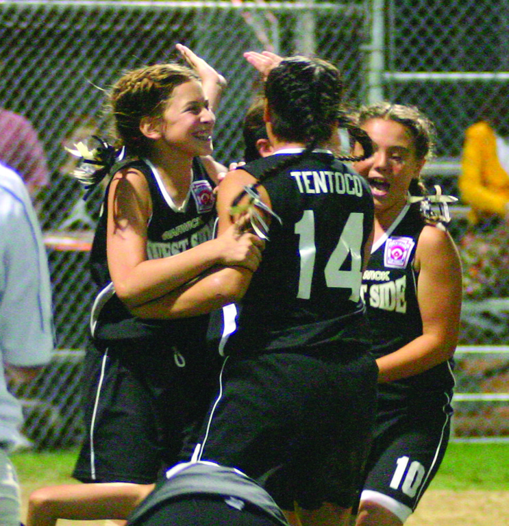 VICTORY DANCE: Lexi Brown, Cassidy Tentoco and Taylor Suffoletto celebrate Monday's District 3 championship victory on Monday night.