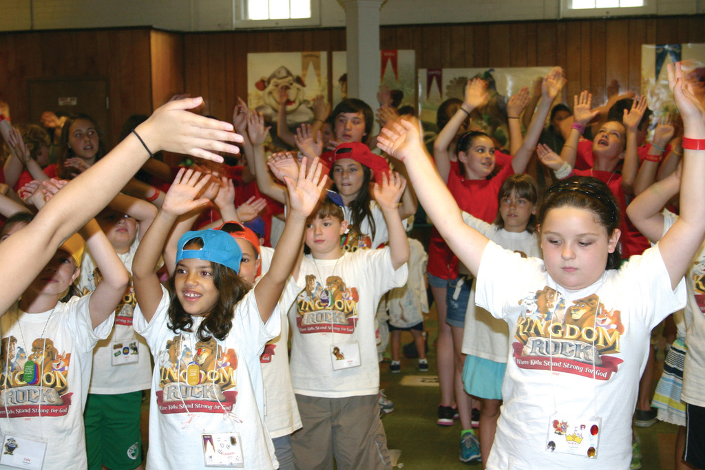 MOVING AND SHAKING: St. Peter's Vacation Bible School campers and counselors dance together for the final presentation put on for their parents the last night of camp.