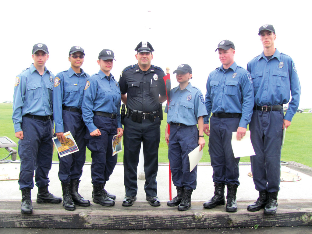 EXPLORER GRADUATES: Members of the Warwick Police Department�s Explorer Post 327 who graduated from the Rhode Island Law Enforcement Training Academy at Narragansett�s Camp Varnum last Saturday are, from left: Cameron Conroy, Adrine Lill, Pamela Rummelle, Officer-Post Advisor Nelson Carreiro, Jennifer Mejia, Zachary Black and Mathew Roy.