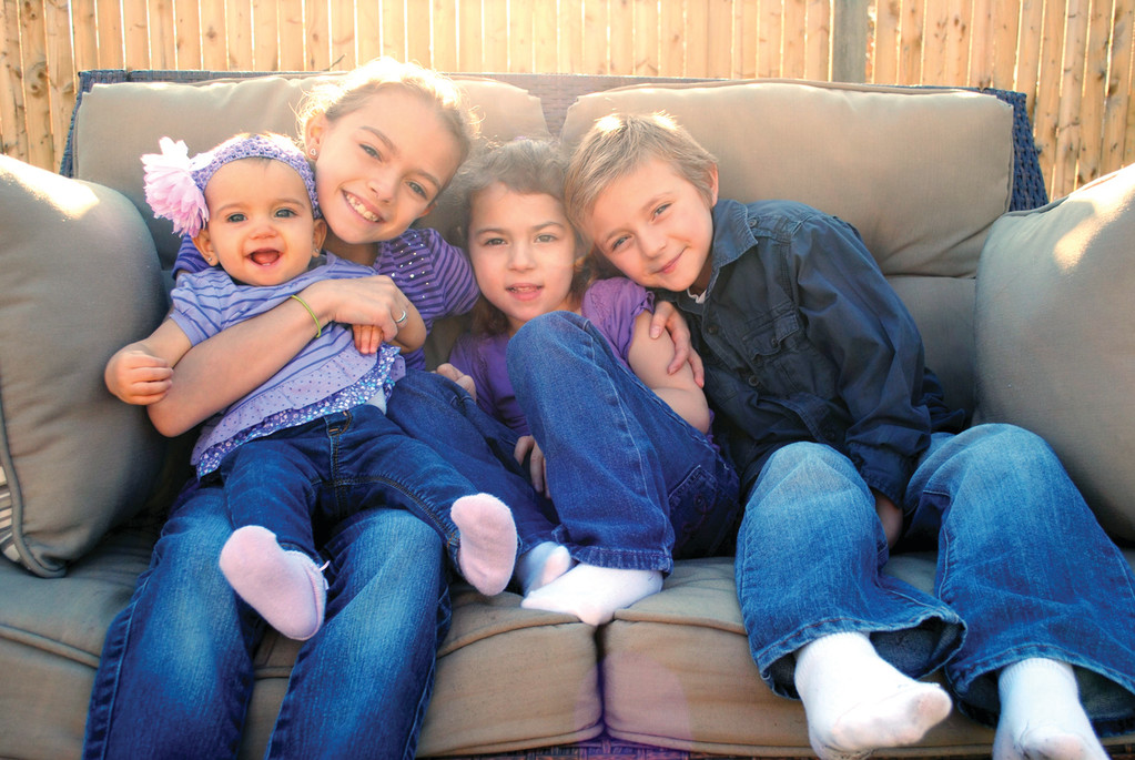 BIRTHDAY GIVERS: From this photo taken in November are Kenley, Callia, Cadence and Kiefer Smith. In honor of their birthdays, the children will host their fifth annual book and toy drive for Hasbro Children's Hospital's Child Life Services program on July 14.