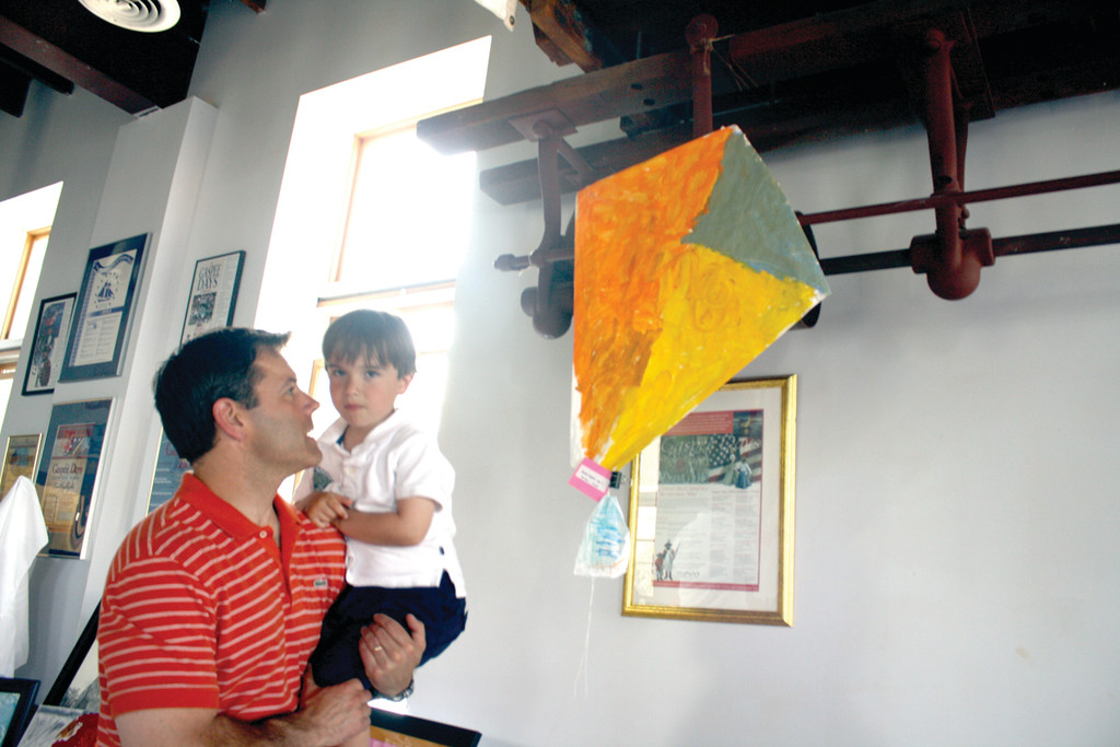 MADE TO FLY: Four-year-old Brett Taylor and his father Jeff closely examine a kite Brett made.