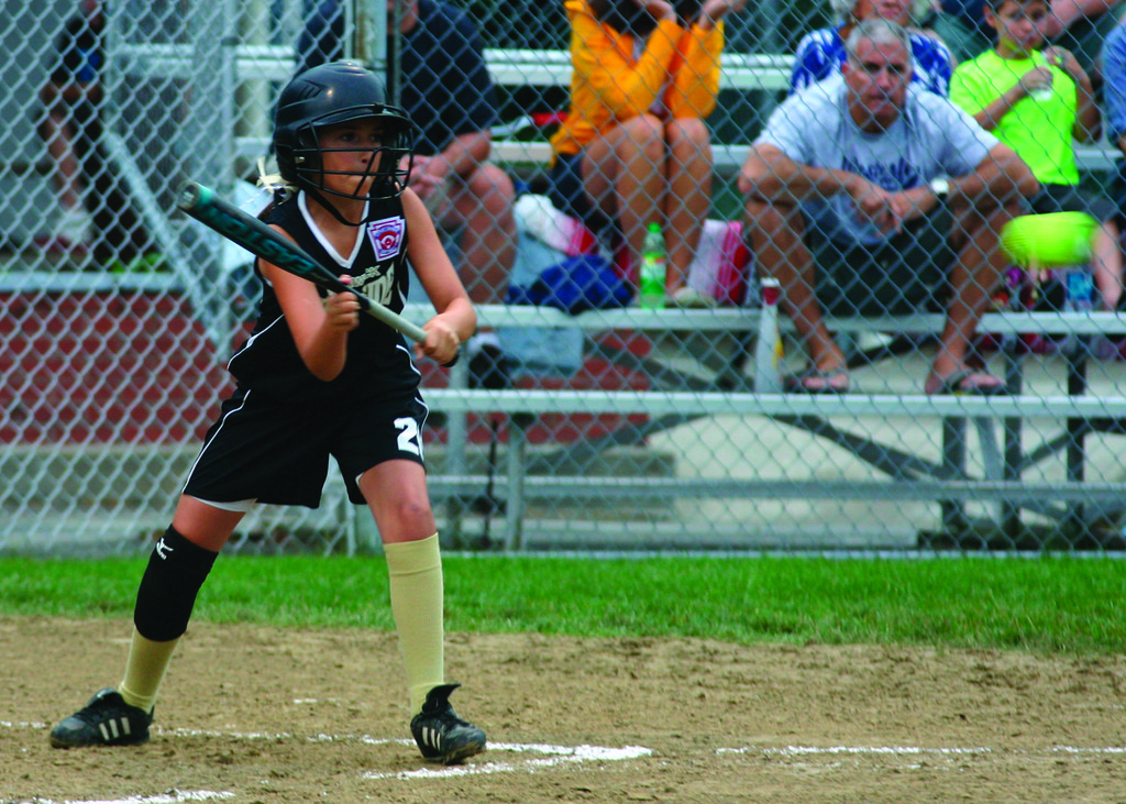 AT THE PLATE: Left, Emma Hlavacek squares to bunt.