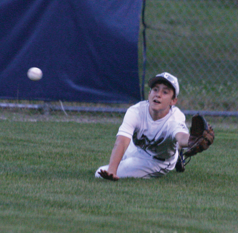 STRETCHING: Mike Hampson makes a diving attempt on a ball in center field during Tuesday�s District 3 tournament game against South Kingstown National. Hampson couldn�t make the catch, but West Side prevailed with a 9-2 victory.