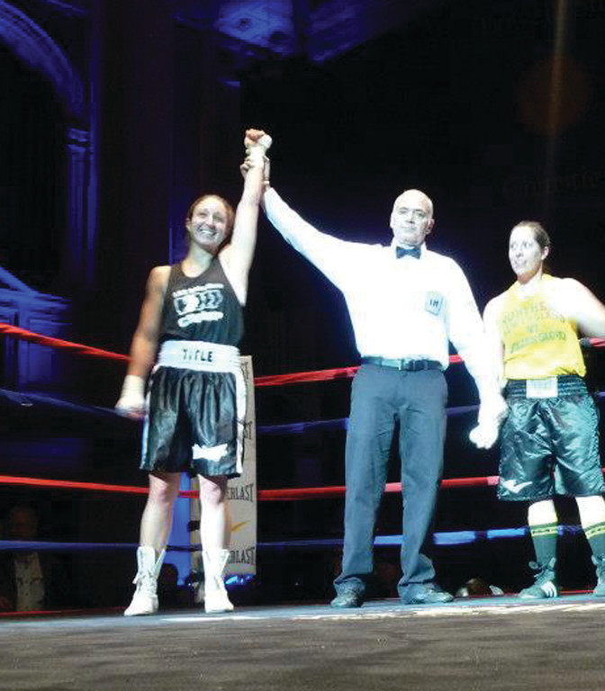 WINNING: Destiny Chearino is all smiles after she beat Liz Leddy in the New England Golden Gloves competition, earning her a place in the national tournament