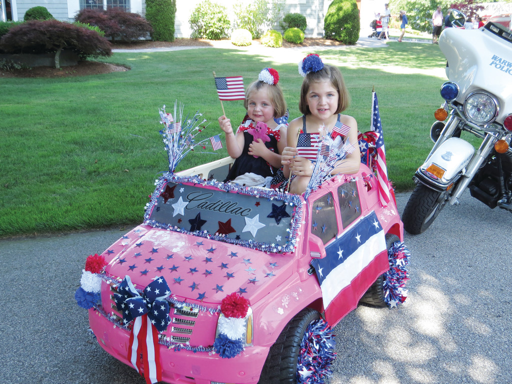 "IN THE PINK FOR THE 4TH: It took Ella and Ava Rataic two days to turn their pink Cadillac into a red, white and blue masterpiece. Driving down the parade route, the sisters smiled and waved, yelling out ""Happy Fourth, people"" to the small group of spectators on Kirby Avenue in the annual Fourth of July Warwick Neck parade.  The parade celebrated its 20th anniversray this year."