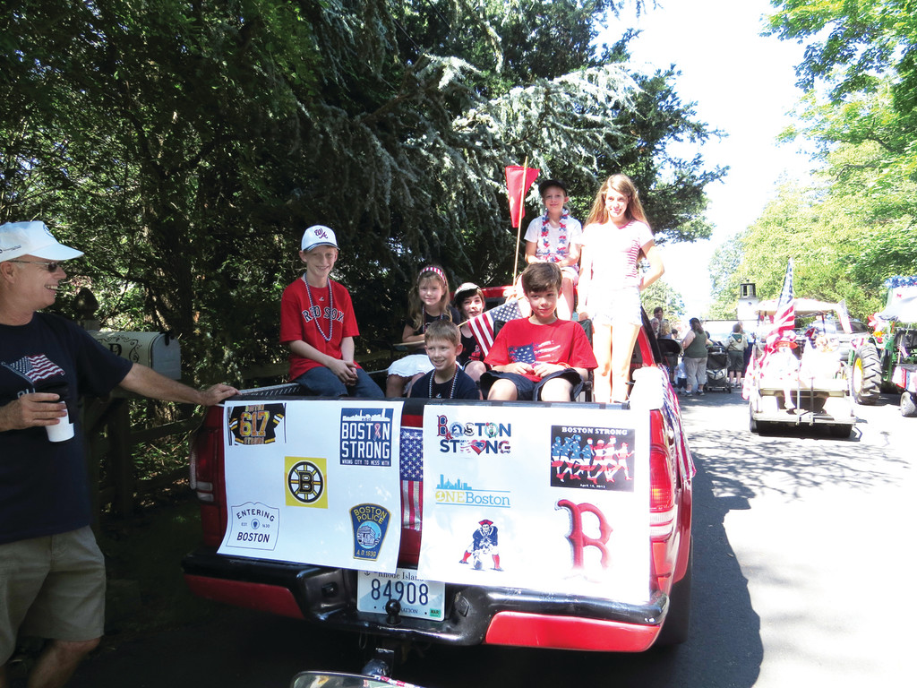 "WARWICK NECK LOVES BOSTON: Senator Bill Walaska and his grandchildren showed their love for Boston sports by decorating their family truck with the logos of the teams and had posters that read ""Boston Strong,"" the slogan used to show support for the city after the bombings at the Boston Marathon."