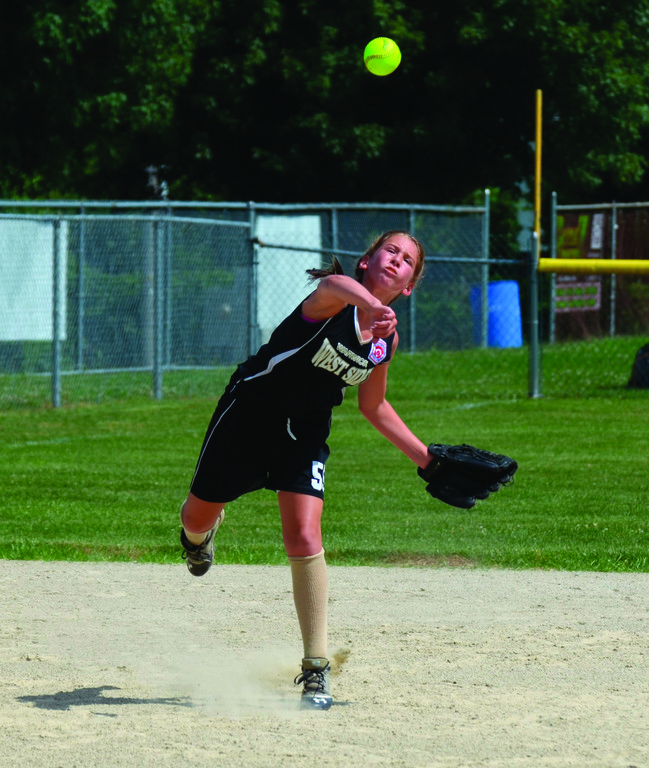Lexi Brown makes a throw across the diamond.