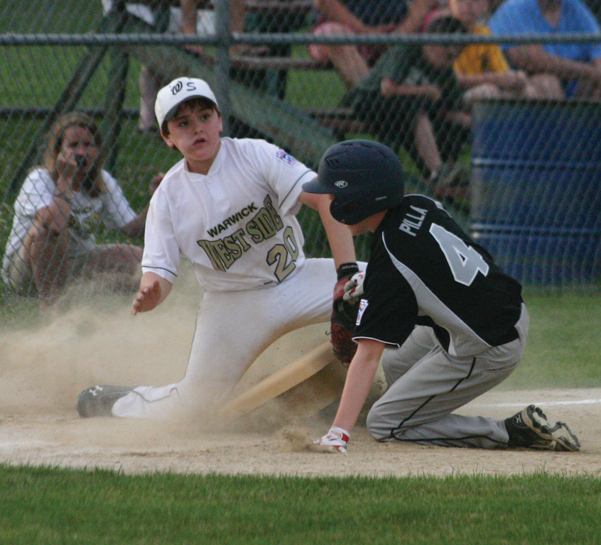 SO CLOSE: West Side's Will Pariseau tags out Coventry National's Griffin Pilla on Sunday. Pilla was out, but the go-ahead run scored in front of him as Coventry ended West Side's Distict 3 Tournament with a 4-3 victory.
