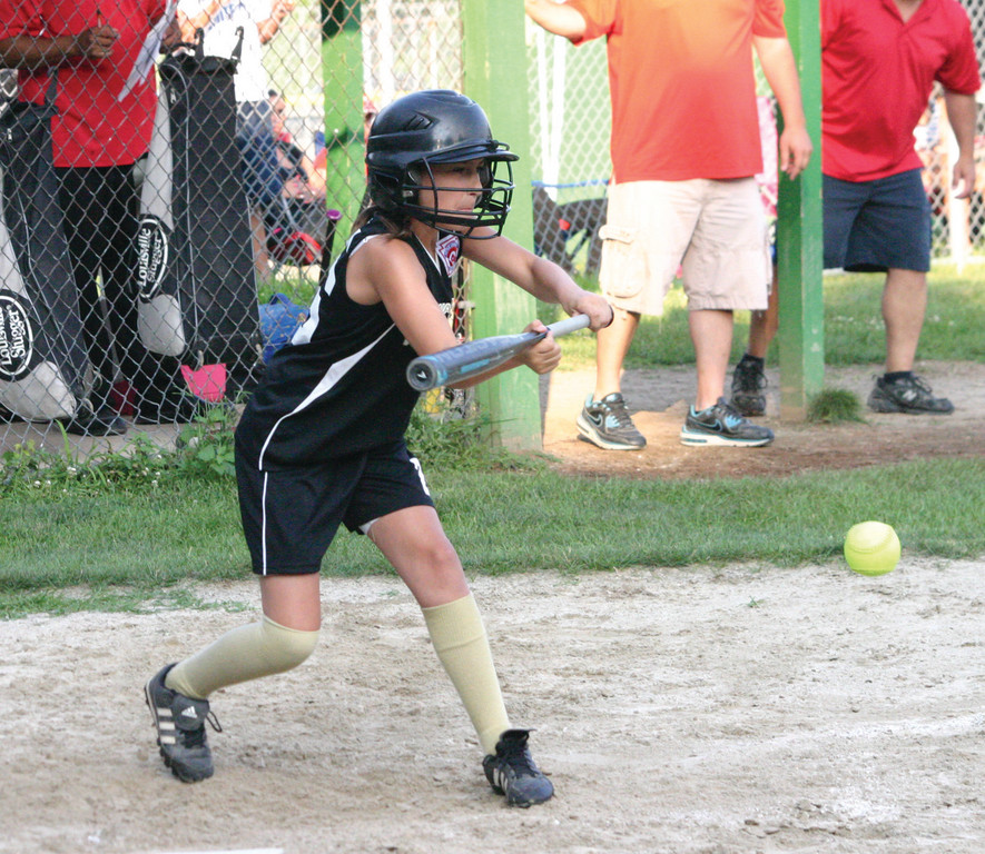 GET IT DOWN: West Side's Emma Hlavacek puts down a bunt in Tuesday's state tournament game. West Side delivered a come-from-behind 4-2 win to stay alive in the tourney.