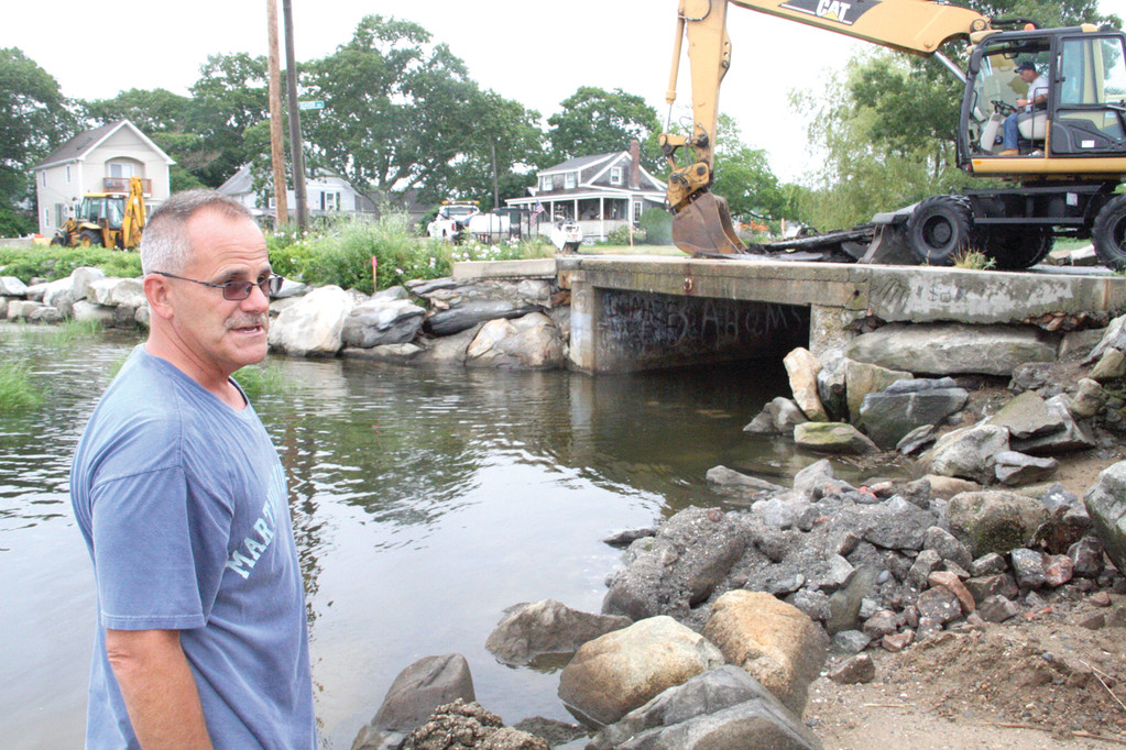 DUE FOR REPLACEMENT: Department of Public Works acting director David Picozzi assesses work as city crews start removing the decking to the bridge on Sea View Drive in Oakland Beach. A new culvert will replace the existing one that is deteriorating.