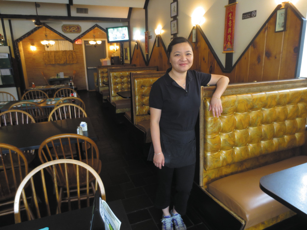 Server Jian Yuan, a native of China who moved here nine years ago, is a proud member of the Jade Dragon family.
