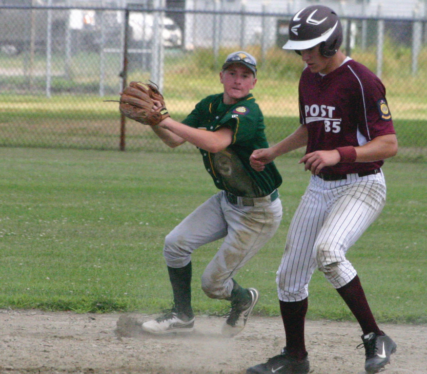CLOSE QUARTERS: Ryan Rotondo makes a play behind a Navigant runner during Sunday's American Legion game. NEFL lost but remains near the head of the pack.