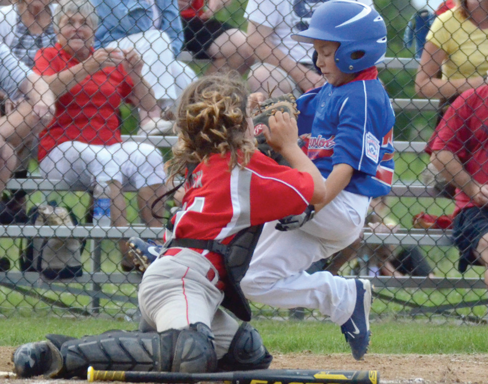Kaden Ethier slides in on a play at the plate.