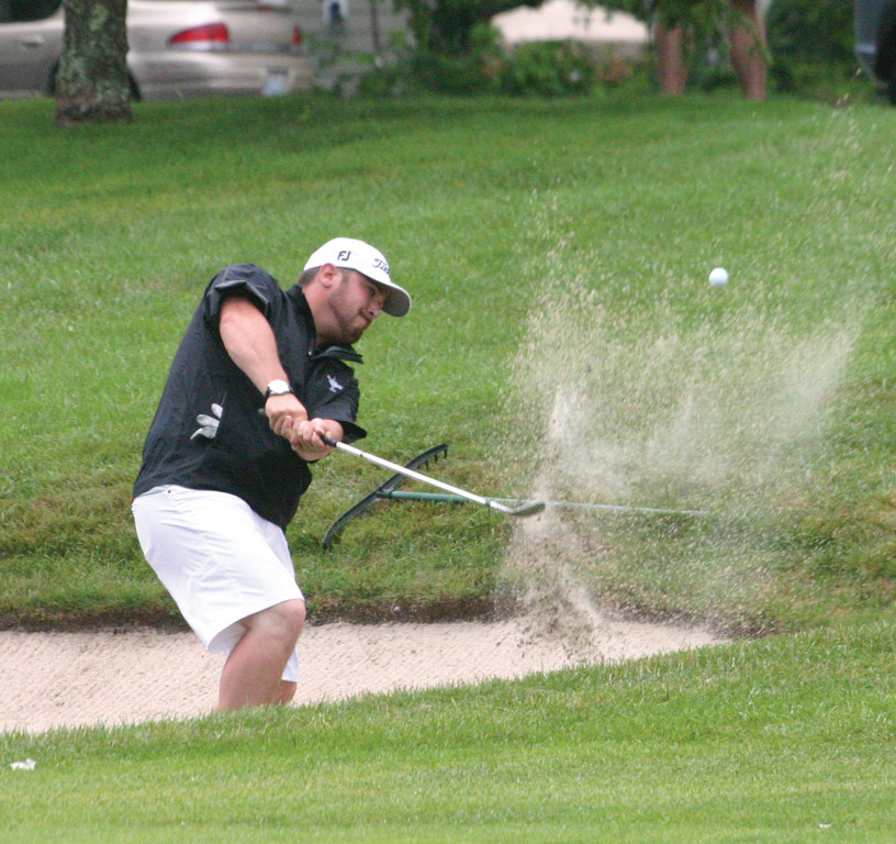 CHAMP AGAIN: Warwick native Brad Valois chips out of a bunker on the 13th hole at Quidnessett during final-round action at the Rhode Island State Amateur.