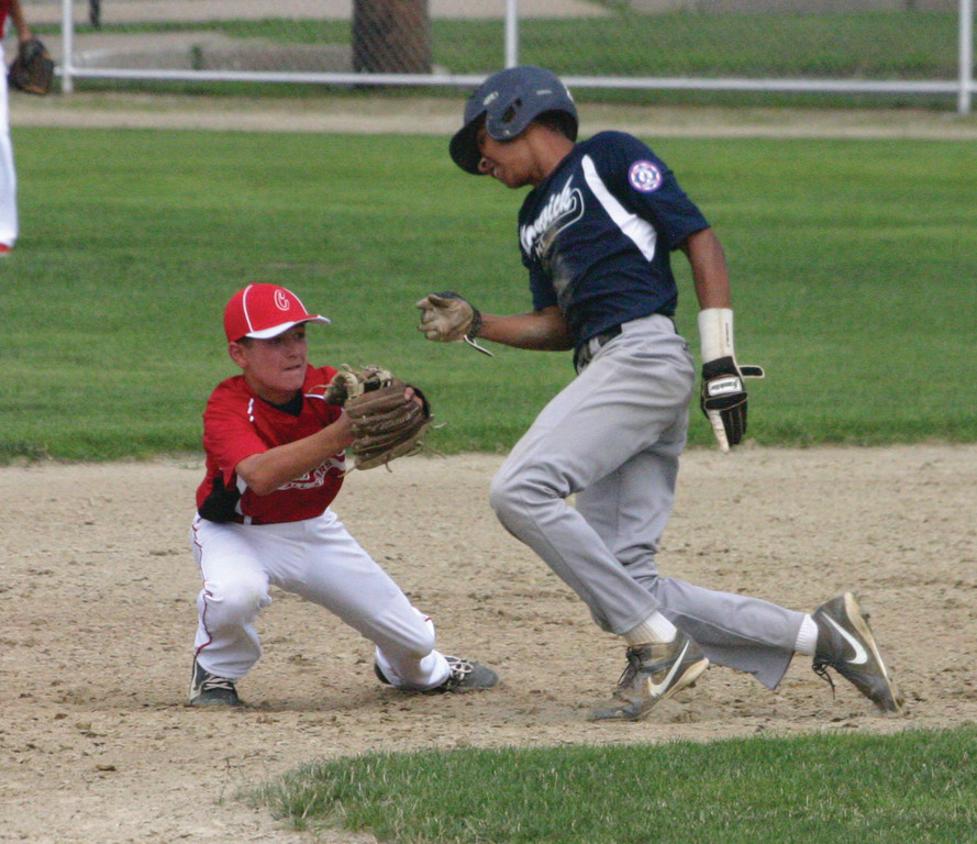 Elijah Brown tries to avoid a tag at second base.