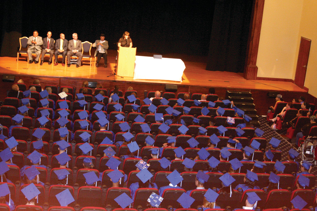 CLASS OF 2013: JoAnne McGunagle, executive director of CCAP, welcomes students, family and friends to the ninth annual CCAP graduation. More than 300 students received high school diplomas after completing the organization�s Learn to Earn program.