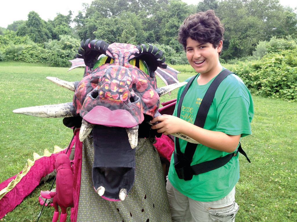 LOGAN BRANCH, age 14, of Warwick, operates the head of the dragon. His mother, Pam Vale Branch, created the head.