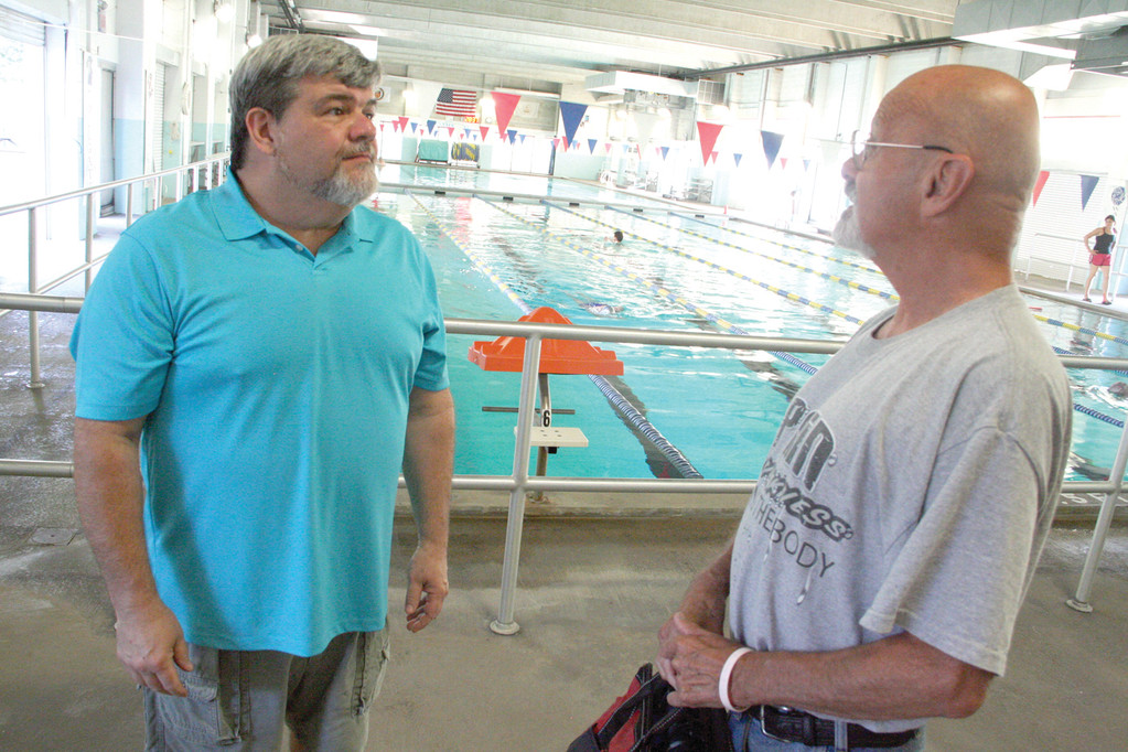 CAN�T BELIEVE THE CHANGES: McDermott Pool manager Jim Dorney, left, talks with Tom Duff yesterday shortly after the pool reopened following extensive renovations.