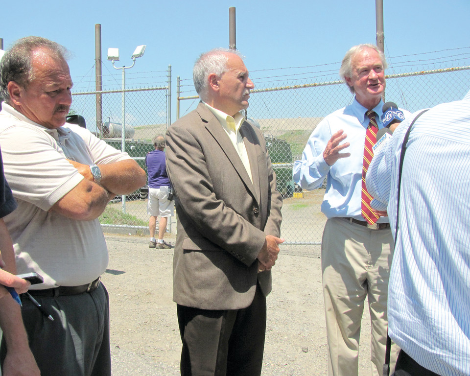 PADLOCKS FOR BROADROCK: Governor Lincoln Chafee joins Mayor Joseph Polisena and Building Official Ben Nascenzi at Broadrock Renewables energy plant after an explosion forced the second closure at the facility.