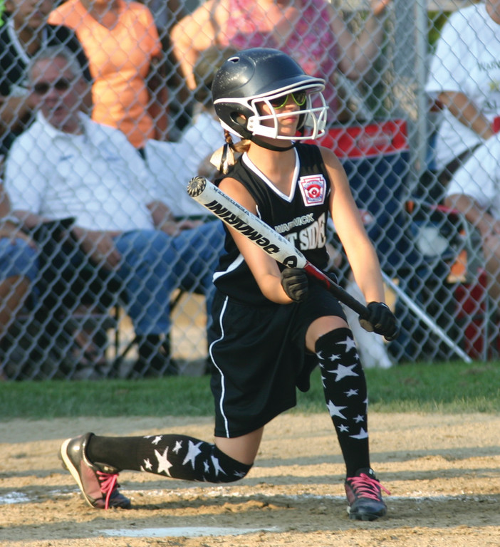 SQUARED UP: West Side's Trinity Reilly gets set to bunt during district tournament action.