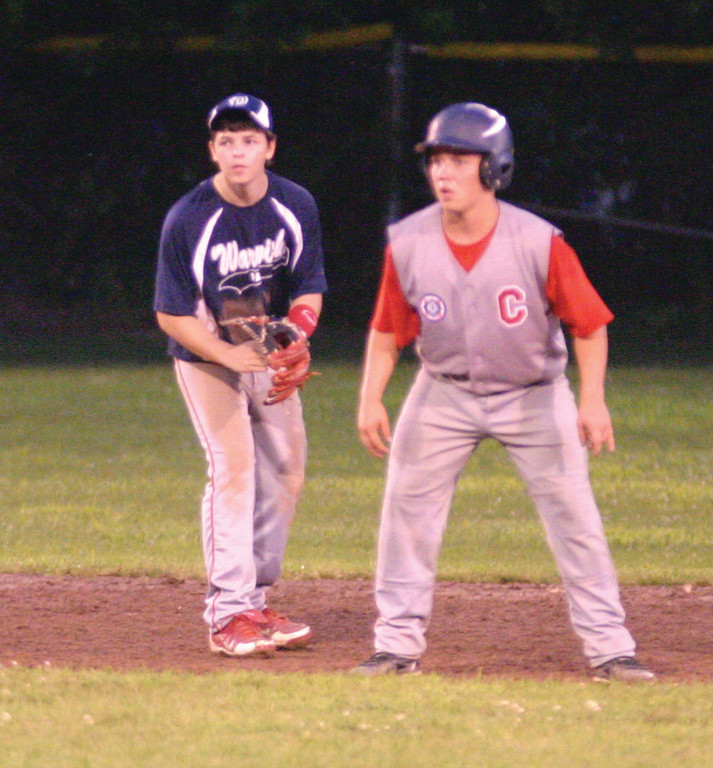 LURKING: Warwick's Steven Foster moves toward second base from his shortstop position while a Coventry runner leads off the bag during the Babe Ruth 15-year-old state tournament.