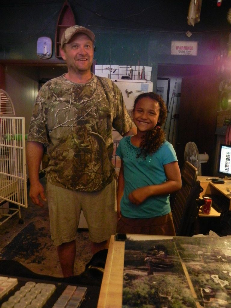 DADDY'S HELPER: Eight-year-old Sarah drops by her father's tackle shop to help out now and again, especially when she wants to make some extra money for other activities. Bruning spends over 90 hours at the shop during the fishing season.