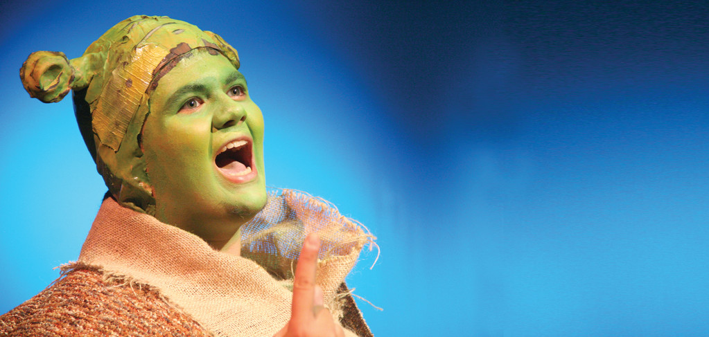 AN IMAGINARY WORLD COMES ALIVE: Mike Villanueva, as Shrek, plays the role of the ogre.