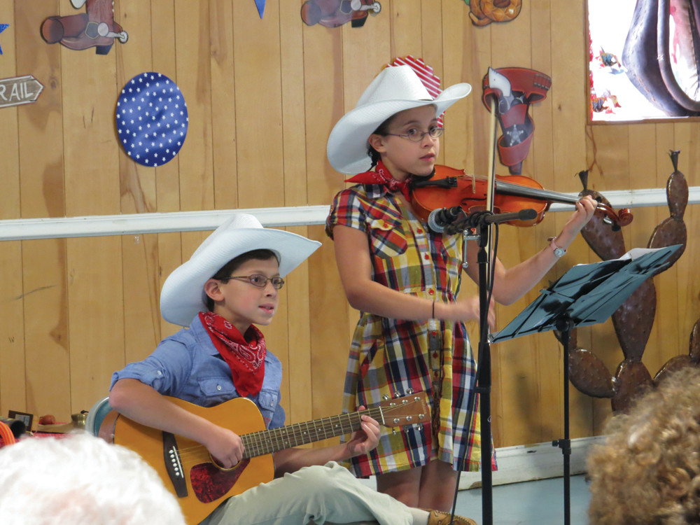 FUTURE COUNTRY STARS: Eleven-year-old Alexandra Nichols and her brother Nathaniel, 12, show off their musical talents performing a medley of country favorites on the fiddle and guitar.
