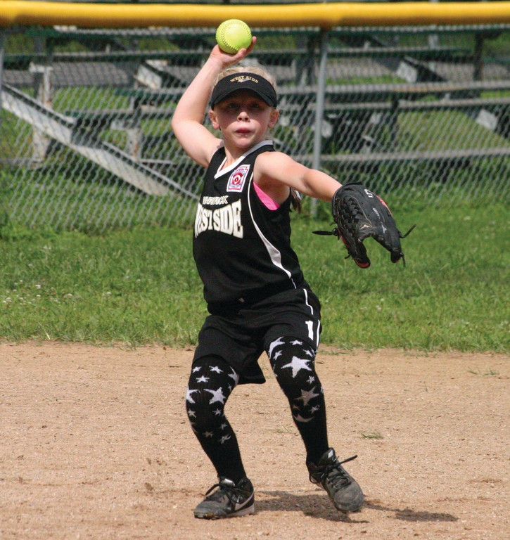 IN THE FIELD: Bryanna Rastella makes a throw to first base.