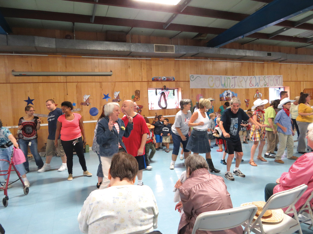SWING DANCING: Following their swing dance performance, professional dancers John and Dee Soares lead a group of audience members in the popular line dance �The Cupid Shuffle� during the Trudeau Center�s first Country & Western Variety Show.