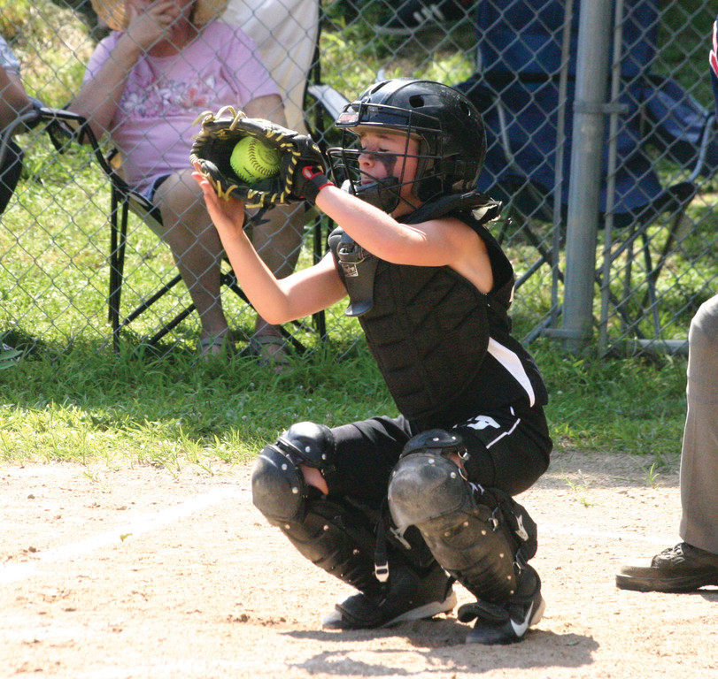 Madi Damato squeezes the ball behind the plate