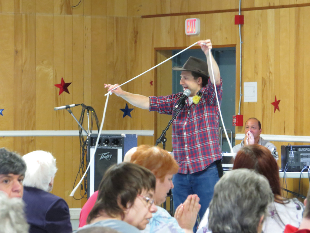 TALLEST COWBOY IN THE WEST: Jay Brunelle entertains the audience at the Trudeau Center by singing �A Cowboy Song� while walking on stilts.