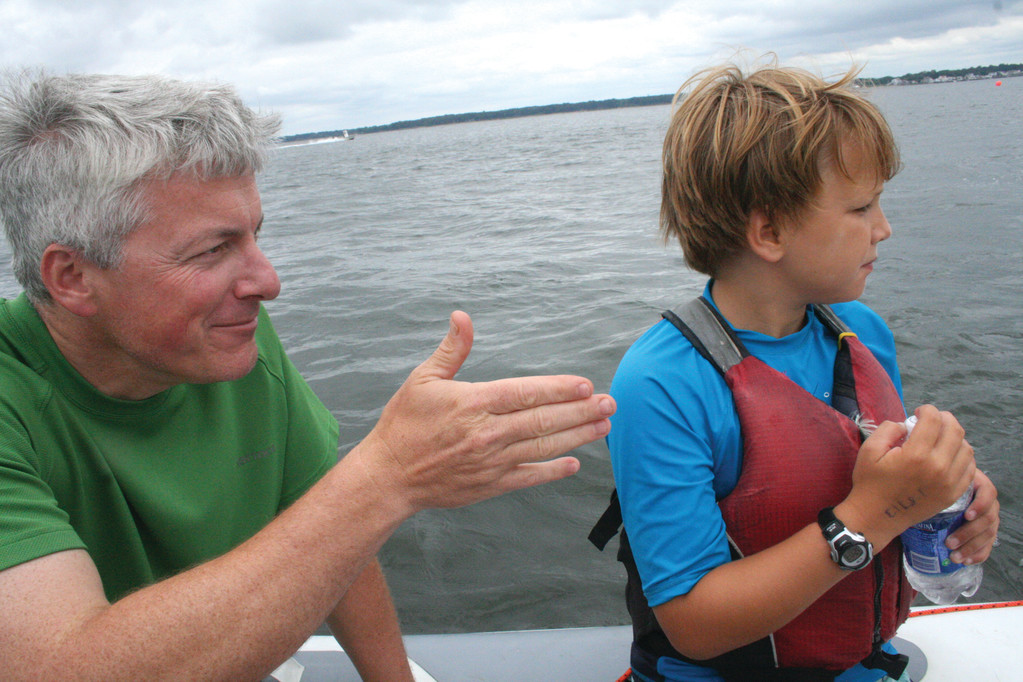 A SAILOR'S ADVICE: Joseph Beaulieu gives his son, Joseph, a few pointers during a youth sailing regatta he organized last summer. To get back and forth from home and the racecourse, Beaulieu used his Sealegs.