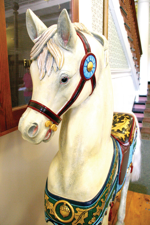 THE FIRST: Acorn, the carousel horse on display at City Hall, is the first of 24 horses being carved for the carousel planned for Oakland Beach.