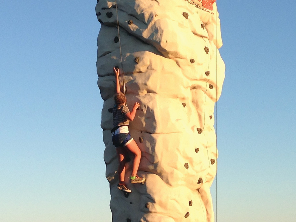 REACHING FOR THE TOP: Jillian Ricci climbing the National Guard�s rock wall and almost making it to the top.