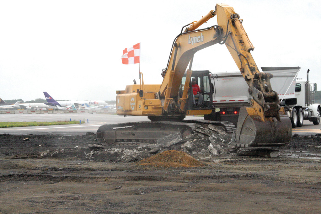 CHUNK BY CHUNK: The end of Runway 34 is being ripped up for the installation of a system designed to slow aircraft that roll off the runway.