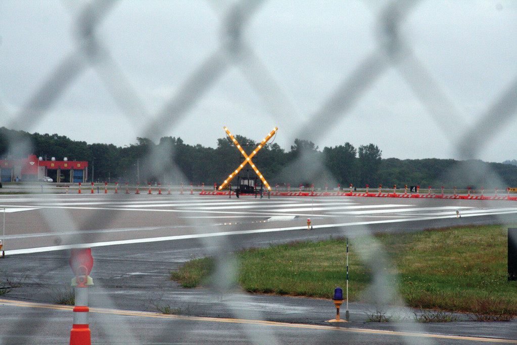 A flashing X alerts pilots that Green Airport�s Runway 34-16 is closed. The runway will reopen in November and stay open for the winter before closing again for construction next summer.