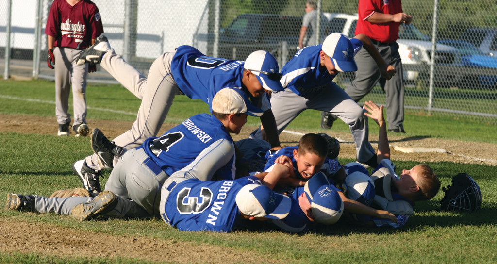 PILE ON: New Jersey players celebrate after winning the Little League 9/10 Eastern Region title in Cranston.