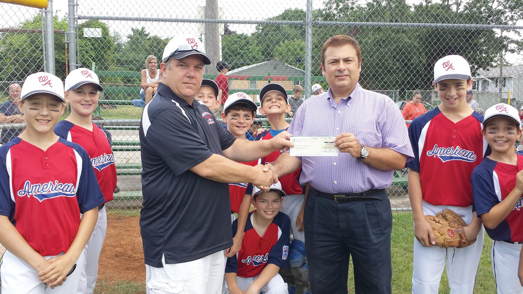 Representative K. Joseph Shekarchi recently represented a $2,000 legislative grant to American Little League. Accepting the grant is Brian Cahill.