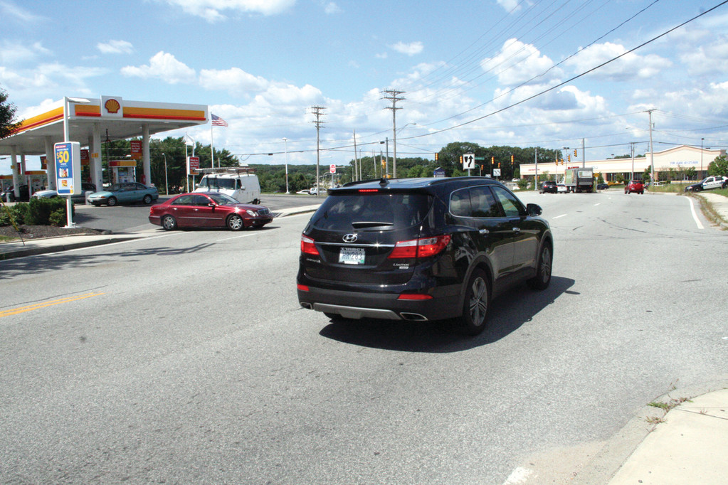 WILL IT PREVENT ACCIDENTS? The family of the late Joel Constantineau would like the state to construct a median to prevent vehicles exiting the Shell station from making a left turn onto Main Avenue.