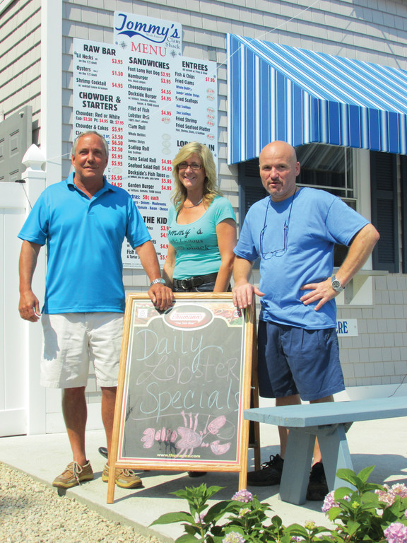 PATRICK'S PEOPLE: Tommy's World Famous Clam Shack is owned and operated by Tommy Patrick (left), who also owns the adjacent Dockside Seafood and Marketplace. He's joined at the Daily Specials board by Manger Doreen Parente and Chef Stephen Delory.