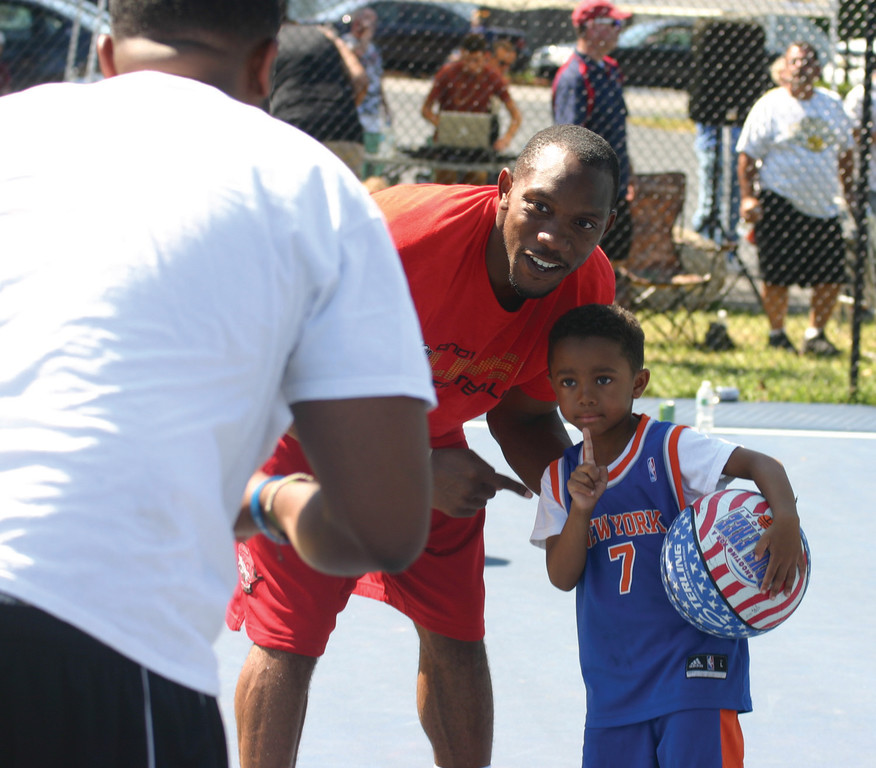 And1�s C.J. poses with a young fan.