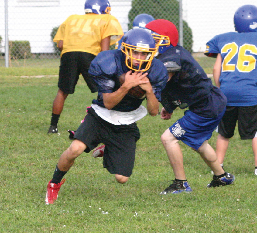 Kyle Agin makes an interception during practice.