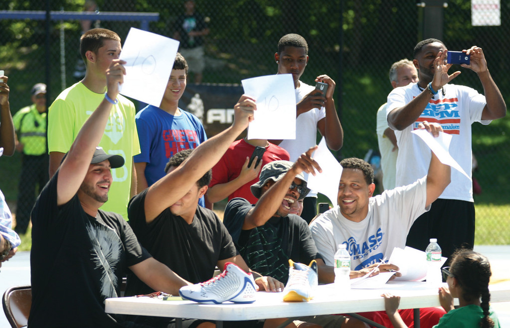 THE JUDGES AGREE: The judges at And1�s dunk contest flash a parade of 10�s.