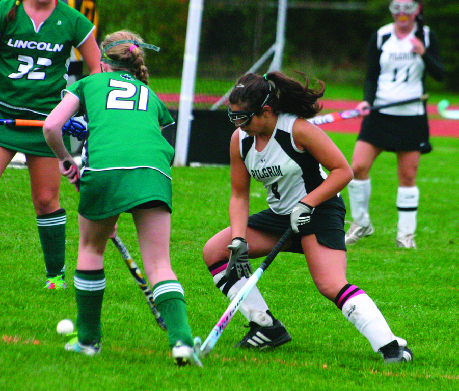 TOUGH SLATE: Pilgrim's Jessica Pope battles for possession of the ball during a game last season. The Pats are in Division I for a fourth straight season.
