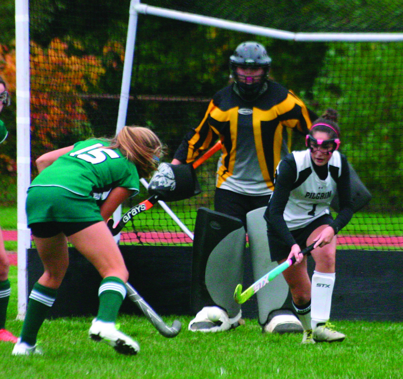 LAST LINE OF DEFENSE: Pilgrim goalie Courtney Cardoza gets in position during a game last year. As part of a team that has struggled in Division I, Cardoza likely sees more shots than any goalie in the state, but she doesn't mind.