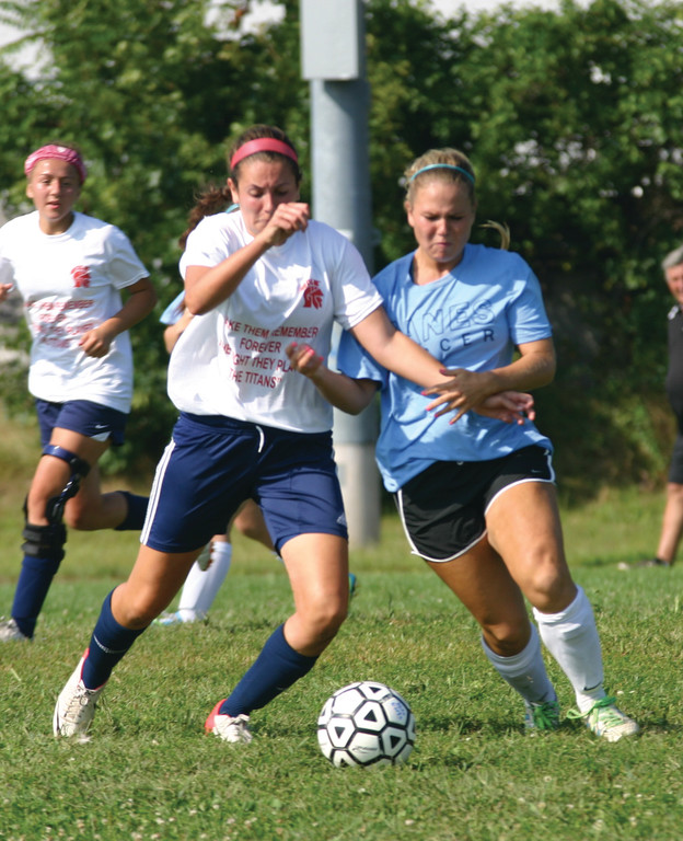 BATTLING: Jami Derderian battles for a ball.