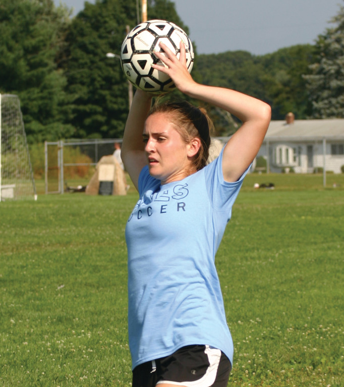 BACK IN PLAY: Ricki Beaufort takes a throw-in during the Warwick Vets Fall Soccer Tournament.