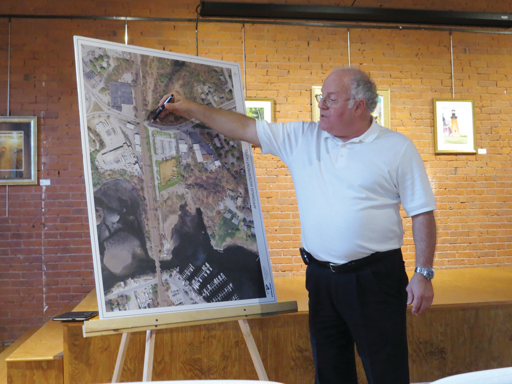 ON THE MAP: Ray D'Abate, the developer behind the proposed Apponaug hotel, shows his audience a map of the West Shore Road area complete with an overlay of where the proposed hotel will be.