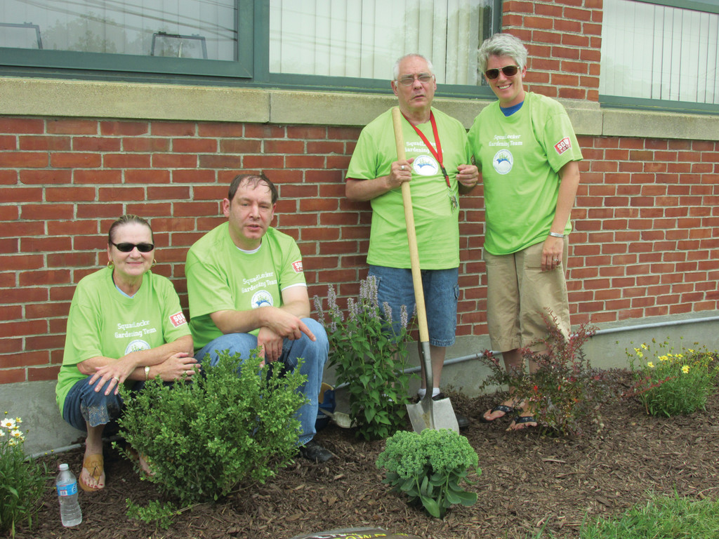 GREEN GARDENERS: Among the Trudeau Center officials and members who took part in last Thursday's official dedication ceremony of a beautification partnership were (from left) Sandy McKay, David Crowley, James Fadgen and Melissa Miller.
